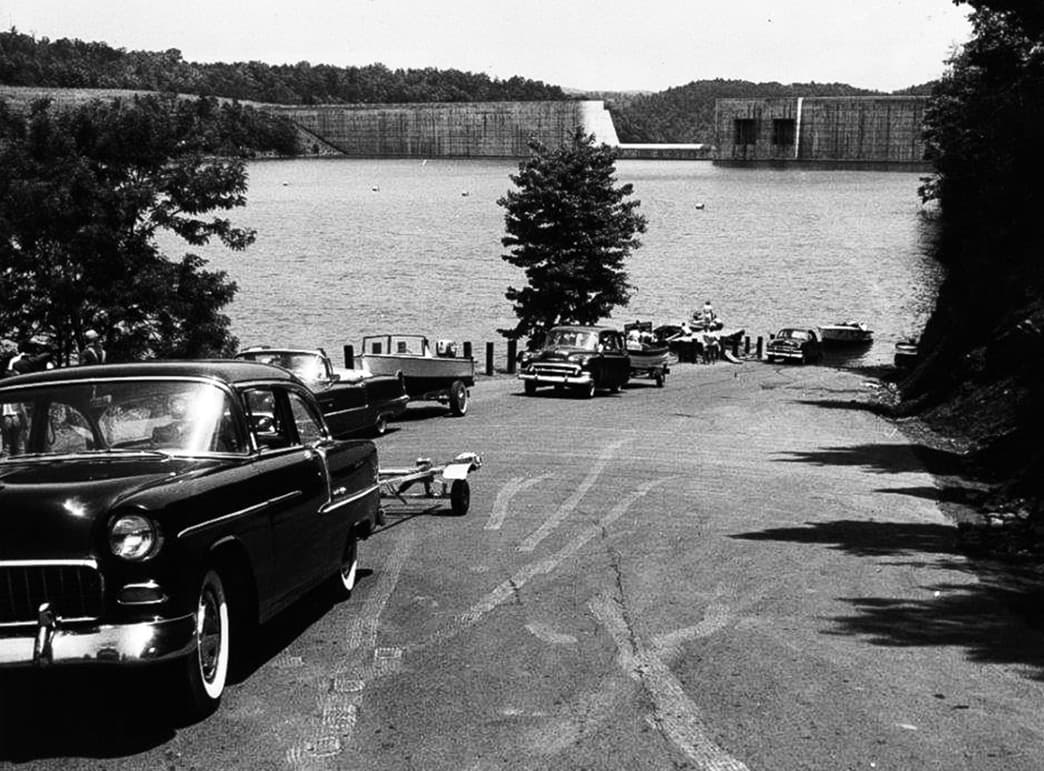 Black and white photo of cars on a road by Philpott Lake